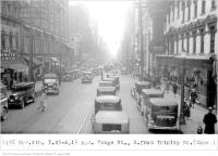 Historic photo from Tuesday, November 4, 1930 - Traffic at 4 p.m., Yonge St, south, from Trinity Square in Downtown