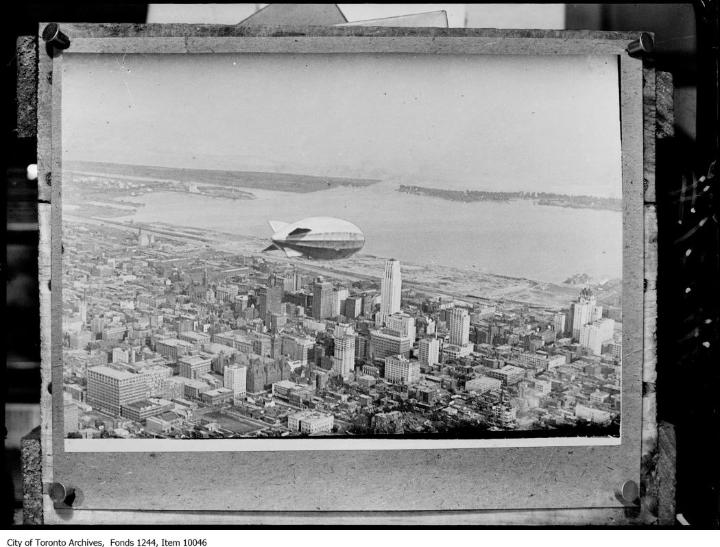 Item 10046 - Dirigible R101 over downtown (composite) - [ca. 1930]