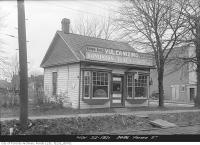 Historic photo from Tuesday, November 22, 1921 - Cumming Bros. Auto Accessories shop at 2486 Yonge Street in North Toronto