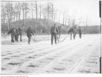 Historic photo from 1909 - Men and horses cutting ice on Grenadier Pond in High Park