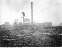 Historic photo from Thursday, November 21, 1918 - View of the plant from the west, showing the butyl tank, capacity 1.4 million gallons; boiler house, with distillery and mill in the distance in Distillery District