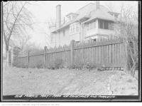 Historic photo from Friday, May 1, 1936 - Stone gate, wooden fence, and house behind on Constance and Parkside in High Park