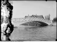 Historic photo from Friday, May 26, 1911 - Single span bridge at Centre Island with a canoe docked in Toronto Island