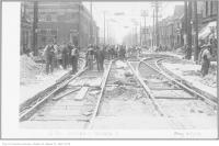 Historic photo from Tuesday, May 22, 1923 - Men working on the streetcar tracks at Dundas and McCaul West in Art Gallery of Ontario